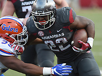 NWA Democrat-Gazette/MICHAEL WOODS • @NWAMICHAELW<br /> University of Arkansas running back Rawleigh Williams III tries to get past Florida defender David Reese in the 4th quarter Saturday, November 5, 2016  during the Razorbacks 31-10 win at Razorback Stadium in Fayetteville.