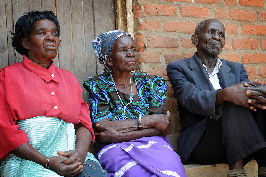 ELDERLY PEOPLE IN THE VILLAGE OF KASARIKA, MALAWI, WHO WERE ACCUSED OF BEING WITCHES AND PERSECUTED BY FAMILY AND NEIGHBOURS BEFORE THE GOOD SAMARITAN PROJECT RESOLVED THE SITUATION. LEFT TO RIGHT: ENITA NGULAMA, 69, ULALIA AND BILLY THOMAS, 81. . PICTURE BY CLARE KENDALL. 6/11/12