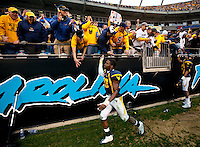 West Virginia players celebrate defeating North Carolina during the Meineke Car Care Bowl college football game at Bank of America Stadium in Charlotte, NC.