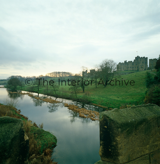 Alnwick Castle seen from the bridge over the River Alne
