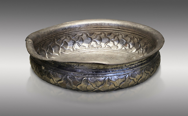 Mycenaean silver cup from the Tomb 78 of the Mycenae chamber tombs, Greece. National Archaeological Museum Athens. Grey Background<br /> <br /> This Mycenaean silver cup has a repousse  scale pattern with wish bone handles. Cat No 3121. 16th Cent BC