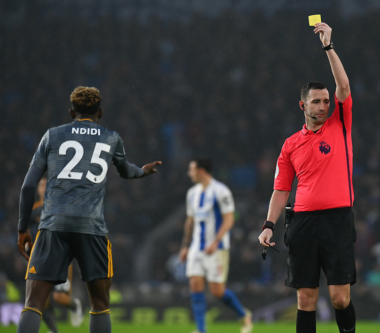 Leicester City's Wilfred Ndidi (left) is shown a yellow card by referee Christopher Kavanagh for his foul on Brighton & Hove Albion's Beram Kayal <br /> <br /> Photographer David Horton/CameraSport<br /> <br /> The Premier League - Brighton and Hove Albion v Leicester City - Saturday 24th November 2018 - The Amex Stadium - Brighton<br /> <br /> World Copyright © 2018 CameraSport. All rights reserved. 43 Linden Ave. Countesthorpe. Leicester. England. LE8 5PG - Tel: +44 (0) 116 277 4147 - admin@camerasport.com - www.camerasport.com
