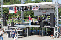 An announcer talks to the crowd at the Lincoln Memorial prior to the annual Rolling Thunder Ride for Freedom which honors veterans, POWs, and MIAs