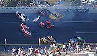 Oct 5, 2008; Talladega, AL, USA; NASCAR Sprint Cup Series driver Reed Sorenson (41), Carl Edwards (99), Kevin Harvick (29) and Juan Pablo Montoya (42) crash during a multi-car accident as Jimmie Johnson (48) goes low to avoid the crash in the Amp Energy 500 at the Talladega Superspeedway. Mandatory Credit: Mark J. Rebilas-