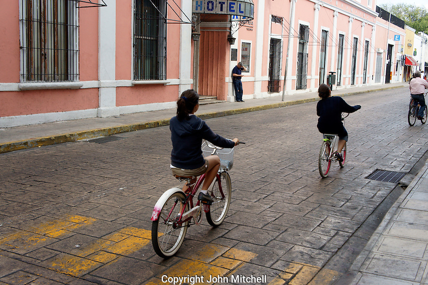 People riding bicycles during Sunday bici ruta on Calle 60 in Merida, Yucatan, Mexico...