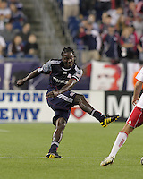 New England Revolution midfielder Shalrie Joseph (21) follows through on a shot. The New England Revolution defeated the New York Red Bulls, 3-2, at Gillette Stadium on May 29, 2010.