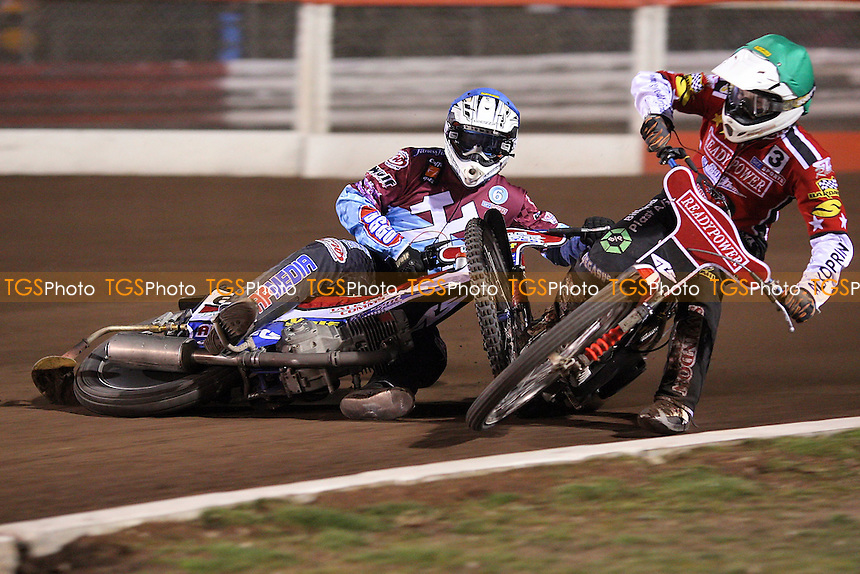 Heat 12: Phil Morris (blue) crashes out with Mads Korneliussen (green) - Lakeside Hammers vs Peterborough Panthers - Sky Sports Elite League Speedway at Arena Essex Raceway, Thurrock - 03/04/09 - MANDATORY CREDIT: Gavin Ellis/TGSPHOTO - Self billing applies where appropriate - 0845 094 6026 - contact@tgsphoto.co.uk - NO UNPAID USE.