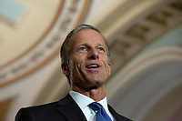 United States Senator John Thune (Republican of South Dakota) speaks at a press conference following weekly policy luncheons on Capitol Hill in Washington D.C., U.S. on July 30, 2019. Credit: Stefani Reynolds/CNP/AdMedia
