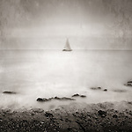 A distant sailing boat on the sea
