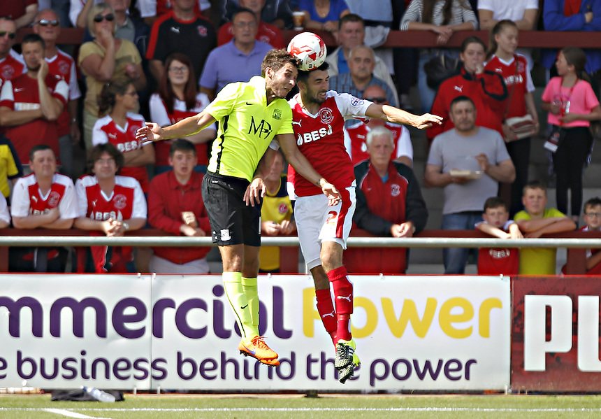 Fleetwood Town's Conor McLaughlin jumps with  Southend United's Will Atkinson<br /> <br /> Photographer Mick Walker/CameraSport<br /> <br /> Football - The Football League Sky Bet League One - Fleetwood Town v Southend United - Saturday 8th August 2015 - Highbury Stadium - Fleetwood<br /> <br /> &copy; CameraSport - 43 Linden Ave. Countesthorpe. Leicester. England. LE8 5PG - Tel: +44 (0) 116 277 4147 - admin@camerasport.com - www.camerasport.com