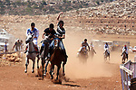 Palestinian jockeys compete during a horse race in the West Bank village of Abu Falah, near the town of Ramallah ,on 02 September 2011. Some 60 horses in different heats participated in races through the day, attracting jockeys from across the West bank and from some Arab-Israeli towns. Photo by Issam Rimawi