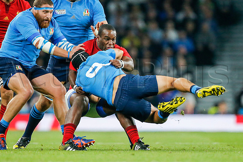 19.09.2015. Twickenham, London, England. Rugby World Cup. France versus Italy. Edoardo Gori of Italy is tackled by Eddy Ben Arous of France.