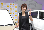 Japanese actress Juri Ueno, 22,  poses with the new Life compact car. Ueno appears in its TV commercials. The standard models will be released on Friday and special mobility-assist model for handicapped users on Dec 5. The price range will be 945,000 yen to 1,680,000 yen.