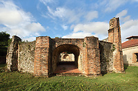 Tunnel at the Boca de Nigua or Nigua sugar mill, 17th century, at San Gregorio de Nigua, near Santo Domingo, in the Dominican Republic, Caribbean. The mill was founded by Marquee De Aranda and later owned by Juan Bautista Ollarazaba, and was an important site for the sugar industry, with a mill, furnaces, boiling room, warehouse, guardhouse, distillery and Spanish colonial buildings. The mill is built in the style of the great Cuban and Haitian mills erected late 18th century. It was the site of the first slave rebellion 1796. Restoration began here in 1978 under Baez Lopez-Penha. Picture by Manuel Cohen