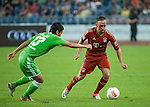 Franck Ribery of Bayern Munich and Makoto Hasebe of VfL Wolfsburg in action during a friendly match as part of the Audi Football Summit 2012 on July 26, 2012 at the Guangdong Olympic Sports Center in Guangzhou, China. Photo by Victor Fraile / The Power of Sport Images