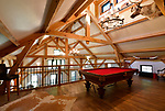 The pool table in the loft area at the home of Steve and Jennifer Schatz. There are also electronic arcade-style games for their children in the loft area. They live in rural Pacific. The open-concept home is designed to resemble a Missouri dairy barn. <br /> Photo by Tim Vizer