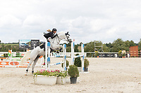 Female rider in jumping competition at Czech Equestrian Masters 2017, at Equitana Martinice