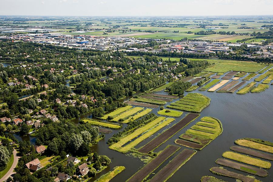 Nederland, Noord-Holland, Broek op Langedijk, 14-07-2008; Gemeente Langedijk, in de voorgrond natuurgebied Oosterdel, links een woonwijk, op het tweede plan bedrijventerrein Zandhorst - wonen, werken, recreeren; verrommeling, verpaupering van het landschap. .luchtfoto (toeslag); aerial photo (additional fee required); .foto Siebe Swart / photo Siebe Swart