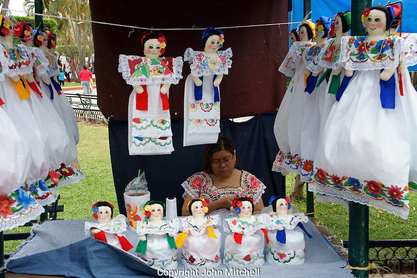 Woman selling embroidered dolls at the Sunday handicrafts markets in the main square, Merida, Yucatan, Mexico......
