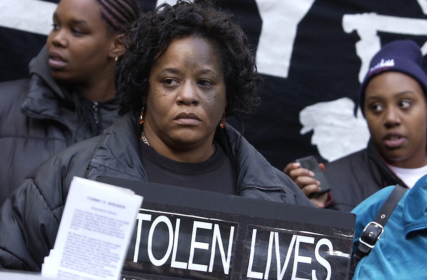 """Gwendolyn Hogan says her husband, Kelsey, was shot 16 times and killed by police in a south side lounge, and that she was notified by a news organization before police. She says she was awarded $250,000 but that no one was convicted in the shooting. Several victims of what they called police brutality came together in the Federal Plaza for the """"8th National Day of Protest to Stop Police Brutality, Repression and the Criminalization of a Generation,"""" sponsored by the Chicago Oct. 22 Coalition.   88732365_Chicago Tribune_Tribune photo by Charles Osgood_10/22/03_NIKON D1H_DSC_3214_NO MAGS/NO SALES/NO INTERNET. ORG XMIT: 88732365..Story Slug: Brutality"""