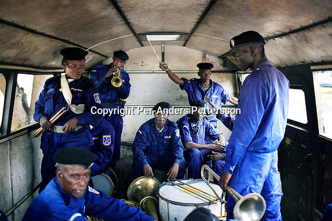 KASANGULU, DEMOCRATIC REPUBLIC OF CONGO APRIL 25: Unidentified members of the Congolese Police brass band pack their instruments in the back of a world war II era truck on April 25, 2006 in Kasangulu, outside Kinshasa, Congo, DRC. They played at a graduation ceremony. The European Union has a cooperation and training program with the Congolese police. They trained the integrated Police Unit (UPI) at the Police school here. European standard training and equipment was given to them. These riot police are to be deployed during the upcoming election campaign and elections in Congo, DRC. The country is in ruins after forty years of mismanagement by the corrupt dictator and former president Mobuto Sese Seko. He fled the country in 1997 and a civil war started. The country is planning to hold general elections by July 2006, the first democratic elections in forty years. (Photo by Per-Anders Pettersson)