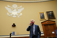 Dr. Anthony Fauci, director of the National Institute for Allergy and Infectious Diseases, talks on his phone before testifying to the House Subcommittee on the Coronavirus Crisis during a hearing on a national plan to contain the COVID-19 pandemic, on Capitol Hill in Washington, DC on Friday, July 31, 2020. <br /> Credit: Kevin Dietsch / Pool via CNP /MediaPunch