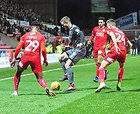 Lincoln City's Michael O'Connor shields the ball from Swindon Town's Ali Koiki, left, and Scott Twine<br /> <br /> Photographer Andrew Vaughan/CameraSport<br /> <br /> The EFL Sky Bet League Two - Swindon Town v Lincoln City - Saturday 12th January 2019 - County Ground - Swindon<br /> <br /> World Copyright &copy; 2019 CameraSport. All rights reserved. 43 Linden Ave. Countesthorpe. Leicester. England. LE8 5PG - Tel: +44 (0) 116 277 4147 - admin@camerasport.com - www.camerasport.com