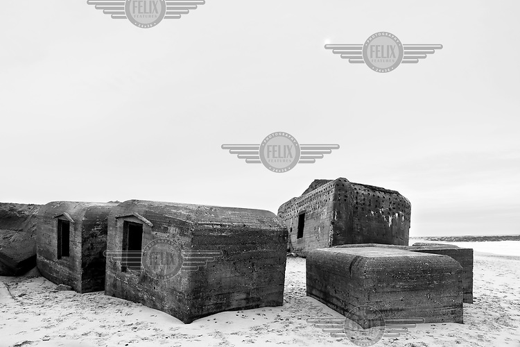Pieces of a defensive structure lie scattered across a beach along the route of the Atlantic Wall (Atlantikwall in German).The Atlantic Wall (or Atlantikwall in German) was a system of defensive structures built by Nazi Germany between 1942 and 1945, stretching over 1,670 miles (2,690 km) along the coast from the North of Norway to the border between France and Spain at the Pyrenees. The wall was intended to repulse an Allied attack on Nazi-occupied Europe and the largest concentration of structures was along the French coast since an invasion from Great Britain was assumed to be most likely. Slave labour and locals paid a minimum wage were drafted in to supply much of the labour. There are still thousands of ruined structures along the Atlantic coast in all countries where the wall stood except for Germany, where the bunkers were completely dismantled.