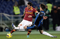 Calcio, ottavi di finale di Coppa Italia: Roma vs Atalanta. Roma, stadio Olimpico, 11 dicembre 2012..AS Roma defender Ivan Piris, of Paraguay, is challenged by Atalanta defender Carlos Javier Matheu, of Argentina, right, during their Italy Cup last-16 tie football match between AS Roma and Atalanta at Rome's Olympic stadium, 11 december 2012. .UPDATE IMAGES PRESS/Riccardo De Luca