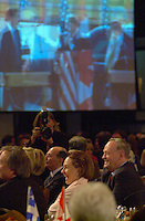 may 14, 2003, Montreal, Quebec, Canada.<br /> <br /> Jean Chretien, Prime Minister of Canada and  Leader of Canada Liberal Party (R) and his wife Aline (L) react to a video (played on the big screen) highlighting  the 40 years long political career of Chretien,<br />  at the annual Liberal party benefit dinner in Montreal, ,  May 14, 2003.<br /> <br /> Chretien will step dow nas leader of the party and as Prime Minister in January 2004 and is most likely to be replaced by former Minister and Finances Paul Martin.<br /> <br /> Mandatory Credit: Photo by Pierre Roussel- Images Distribution. (©) Copyright 2003 by Pierre Roussel
