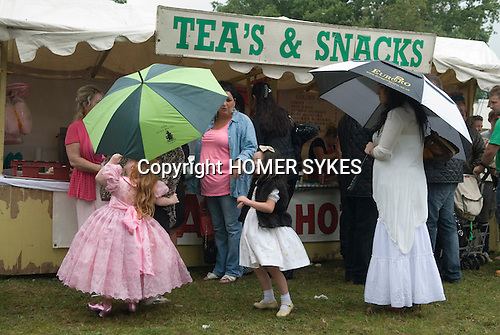 Barnet Gypsy Horse Fair Hertfordshire UK. Gypsy girls in their best clothes with parents and grandmother.