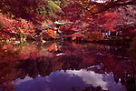 Bentendo Hall pond, surreal colorful autumn scenery at Daigo-ji temple. Shimo-Daigo part of Daigoji complex in fall colors. Shingon Buddhist temple in Fushimi-ku, Kyoto, Japan 2017.