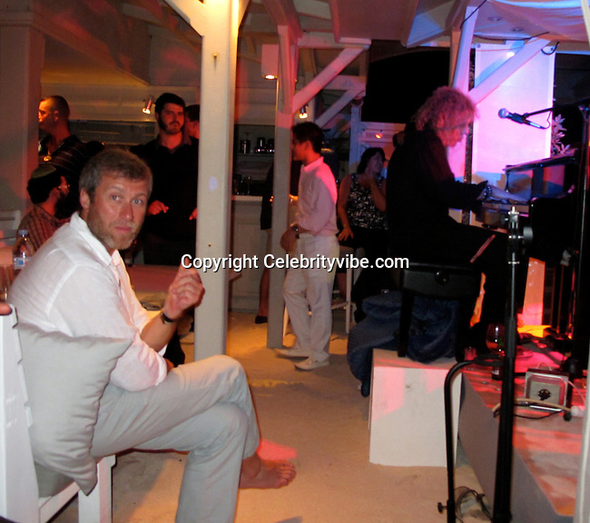 **EXCLUSIVE**.Roman Abramovich and David Bryan, Keyboard Player and Founding Member of Bon Jovi..Roman Abramovich Party..La Plage Restaurant..St Barth, Caribbean..Monday, December 28, 2009..Photo By Celebrityvibe.com.To license this image please call (212) 410 5354; or Email: celebrityvibe@gmail.com ; .website: www.celebrityvibe.com.