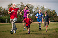 Stacy and Rich Johnson and their  boys, Daniel 9 and Cooper, 7, chase down Travis, 6 at Paseo Vista Park in Chandler.