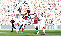 Luciano Narsingh of Swansea City is challenged by Arthur Masuaku of West Ham United during the Premier League match between West Ham United and Swansea City at the London Stadium, England, UK. 08 April 2017