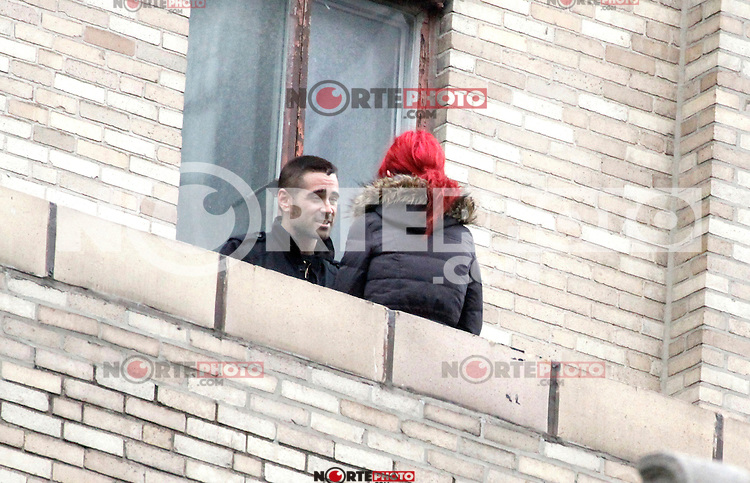 Colin Farrell talking to Original Dragon Tattoo star Noomi Rapace 10 stories up on a roof during filming of Dead Man Down on Walnut Street in Philadelphia, Pa on May 3, 2012  © Star Shooter / MediaPunchInc