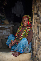 Bangladesh, Cox's Bazar. Kutupalong Rohingya Refugee Camp. The Rohingya, a Muslim ethnic group  denied citizenship in Burma/Myanmar have escaped persecution from Burmese militants in their country. There are up to 500,000 refugees and migrants living in makeshift camps in Cox's Bazar. Woman in the camp.
