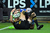 Jordie Barrett rips the ball off Nizaam Carr to score during the Super Rugby match between the Hurricanes and Stormers at Westpac Stadium in Wellington, New Zealand on Friday, 5 May 2017. Photo: Dave Lintott / lintottphoto.co.nz