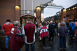 Northampton Town fans gathering outside the Shankly Gates at Anfield, before their team's Carling Cup third round tie away to Liverpool. The visitors from English League 2 defeated Premier League Liverpool on penalty kicks after a 2-2 draw after extra time in one of the biggest shock results in either clubs histories.