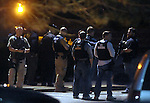 (Watertown Ma 041913)  Law enforcement from multiple agencies man a perimeter just below Walnut Street where the second suspect in the Boston Marathon bombing was believed to be hiding  in a boat in a backyard of a home,  according to scanner reports, as frequent explosions and gun shots could be heard. (Jim Michaud Photo) For Saturday