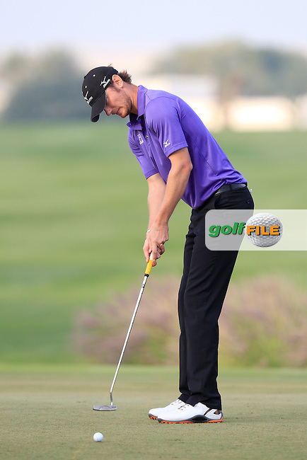 Chris Wood (ENG) takes his eagle putt on the 18th green during Sunday's Final Round of the Commercial Bank Qatar Masters 2013 at Doha Golf Club, Doha, Qatar 26th January 2013 .Photo Eoin Clarke/www.golffile.ie