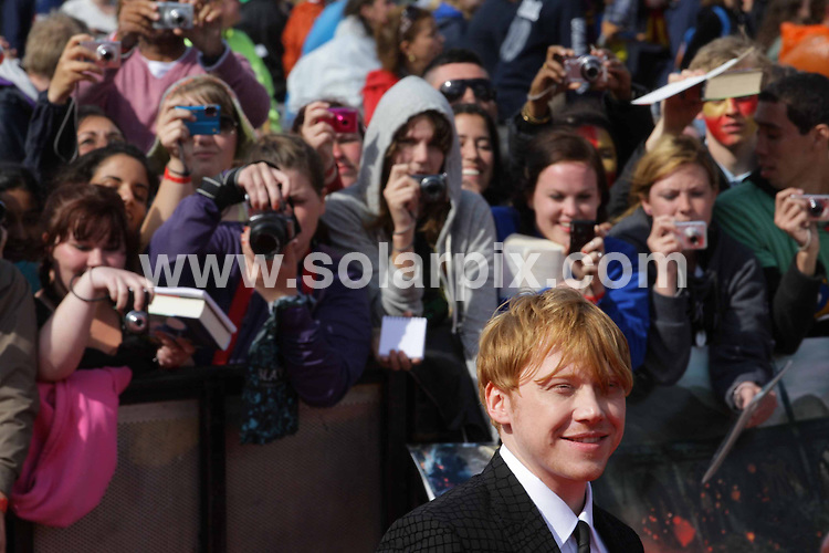 **ALL ROUND PICTURES FROM SOLARPIX.COM**                                             **NO UK NEWSPAPER PUBLICATION**.**UK MAGAZINE & SUPPLEMENT PUBLICATION ONLY** AND NO PUBLICATION IN AUSTRALIA, BELGIUM, FRANCE, GERMANY, ITALY, SCANDINAVIA AND USA**                                                                                  Caption: The World Premiere of the final Harry Potter movie. Harry Potter and the Deathly Hallows: Part 2 - in Trafalgar Square, London, UK. 7 July 2011.                                                                              This pic: Rupert Grint                                                                                     JOB REF: 13677 SFE       DATE:  07_07_2011                                                          **MUST CREDIT SOLARPIX.COM OR DOUBLE FEE WILL BE CHARGED**                                                                      **MUST AGREE FEE BEFORE ONLINE USAGE**                               **CALL US ON: +34 952 811 768 or LOW RATE FROM UK 0844 617 7637**
