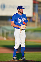 Ogden Raptors starting pitcher Nolan Long (56) looks for the sign before delivering a pitch to the plate against the Great Falls Voyagers in Pioneer League action at Lindquist Field on August 16, 2016 in Ogden, Utah. Ogden defeated Great Falls 2-1. (Stephen Smith/Four Seam Images)