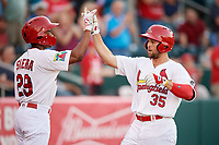 Springfield Cardinals second baseman Dickie Joe Thon (35) is congratulated by Magneuris Sierra (29) after hitting a home run in the bottom of the fifth inning during a game against the Corpus Christi Hooks on May 30, 2017 at Hammons Field in Springfield, Missouri.  Springfield defeated Corpus Christi 4-3.  (Mike Janes/Four Seam Images)
