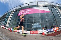31 JUL 2011 - LONDON, GBR - Jarrod Shoemaker passes Building 1000 during the Elite Men's run at the Virgin Active London Triathlon (PHOTO (C) NIGEL FARROW)