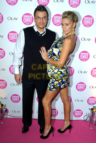 PETER ANDRE & KATIE PRICE - JORDAN.Cosmopolitan Fun Fearless Female Awards 2007 held at Cirque, Leicester Square, London, England. .November 6th 2007 .full length black blue and green spot polka dot patterned print dress halterneck glasses married couple husband wife gold earrings black trousers vest .CAP/CAN.©Can Nguyen/Capital Pictures