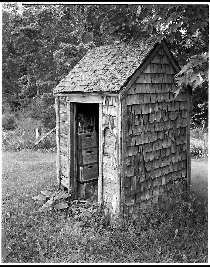 """"""" Elmer's Outhouse""""<br /> Knox County, Maine<br /> 2009<br /> <br /> Elmer's Antiques is a little ways outside of Rockport, Maine. The inside and outside of this place is an very interesting place to explore.  The place is rich with a multitude of eye catching objects small and large.  This old outhouse, now used to store old milk crates, was one of those objects discovered.<br /> <br /> 4 x 5 Large Format Film"""