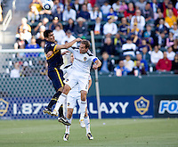 Boca Juniors forward Lucas Viatri (9) battles LA Galaxy midfielder Eddie Lewis (6) for a loose ball. The LA Galaxy defeated Boca Juniors 1-0 at Home Depot Center stadium in Carson, California on Sunday May 23, 2010.  .