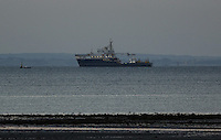 Swansea, UK. Saturday 21 June 2014<br /> Pictured: Galatea ship.<br /> The sun rises over Swansea marking the Summer Solstice and the year's longest day.