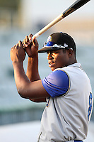 Yasiel Puig #8 of the Rancho Cucamonga Quakes before a game against the Lancaster JetHawks at Clear Channel Stadium on August 22, 2012 in Lancaster, California. Rancho Cucamonga defeated Lancaster 8-7. (Larry Goren/Four Seam Images)